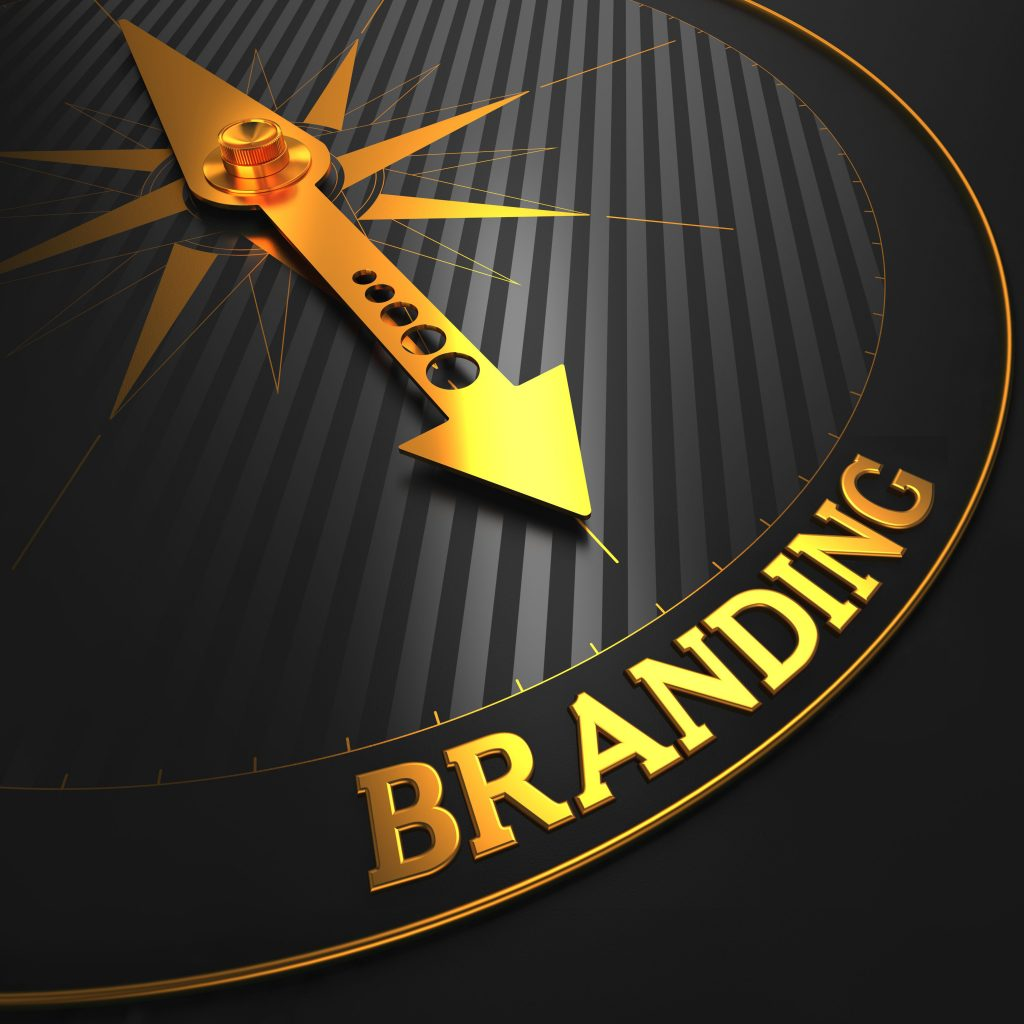 Branding - Business Concept. Golden Compass Needle on a Black Field Pointing to the